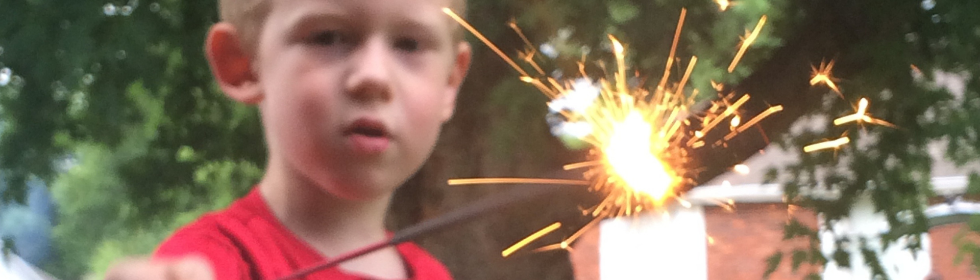 young boy with sparkler